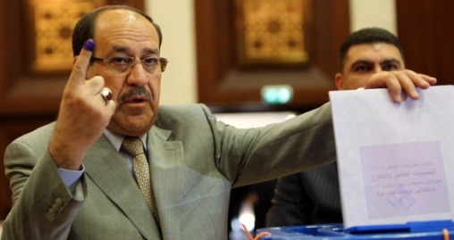 Iraqi Prime Minister Nuri al-Maliki shows his ink-stained finger as he casts his vote in Iraq's first parliamentary election since US troops withdrew at a polling station in Baghdad's fortified Green Zone, on April 30, 2014. Iraqis streamed to voting centres nationwide, amid the worst bloodshed in years, as Maliki seeks reelection. AFP PHOTO / ALI AL-SAADI        (Photo credit should read ALI AL-SAADI/AFP/Getty Images)
