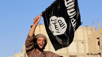 An ISIS fighter celebrates at a parade in Syria's northern Raqqa province