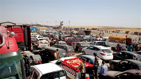 Long queues await those at the Khazair checkpoint