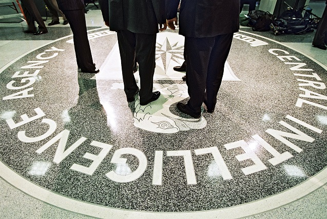 President George W. Bush and CIA Director George Tenet stand on the agency's seal at CIA headquarters in Langley, Va.