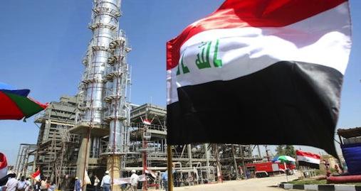 The Iraqi flag flies near an oil refinery in Dora.