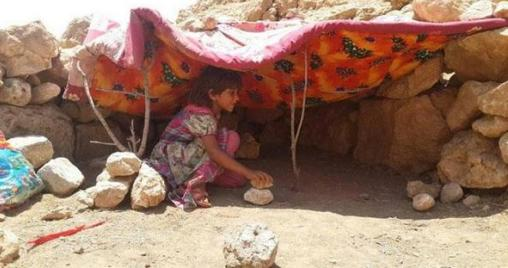 yazidi_child_shelter_sinjar_sun_rocks