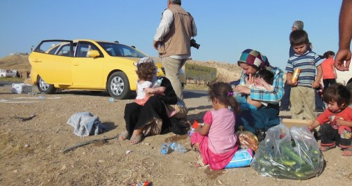 A family on the way out of Mosul in late 2014