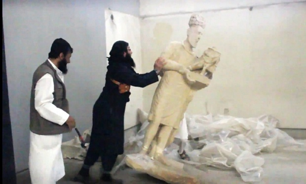 Footage of Isis destroying ancient statues in Nineveh in Iraq. But they do not destroy everything: trade in looted antiquities is another major source of funding for the group