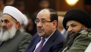 Iraqi Vice President Maliki speaks with Jazaeiri, Deputy Commander General of Saraya al-Khorasani, at a ceremony honouring fighters of group who died during their fight against Islamic State, in Baghdad