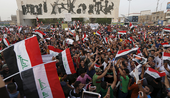 People shout slogans during a demonstration against corruption and poor services regarding power cuts and water shortages at Tahrir Square in central Baghdad, Aug. 7, 2015.
