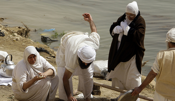 A Sabian Mandaean woman prepares food to mark Eid al-Khalqeh, or Creation of the World, on the banks of the Tigris River in Baghdad