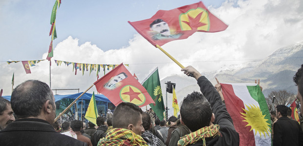 22/03/15 -- Qandil, Iraq -- Crowd cheering and waving PKK flags in front of the celebration platform.