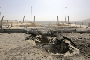 A crater at the Mosul Dam's entrance is evidence of the fight for control of the key resource between Kurdish and Iraqi forces and the Islamic State militants.