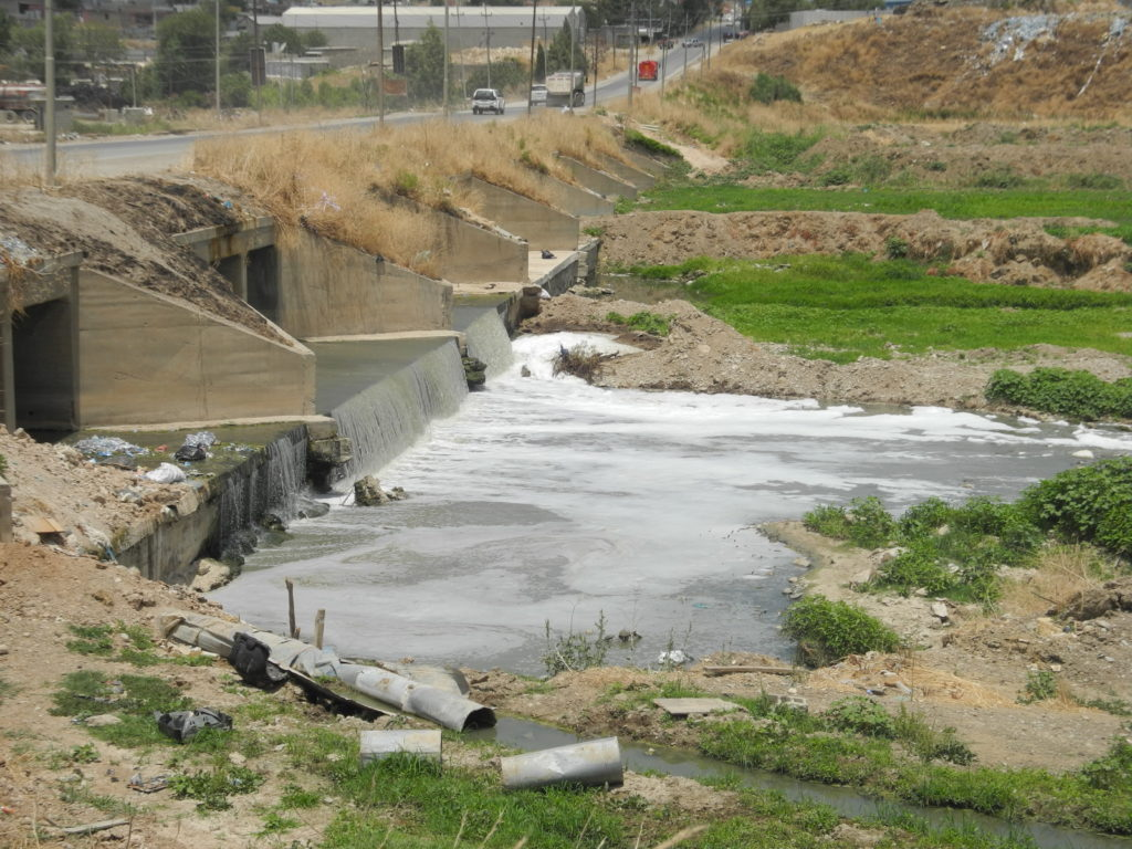Waste spills into the Tanjero River.