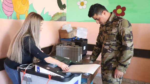 Security Forces, IDPs Cast Votes Early in Iraq's Parliamentary Elections